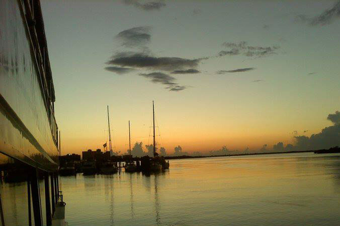 image of sunset over back bay, sailboats