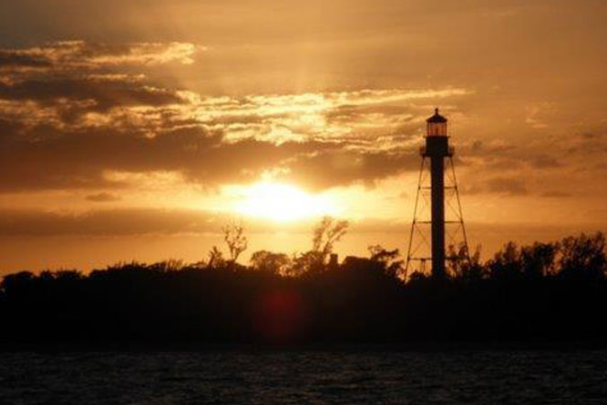 image of sunset Sanibel Lighthouse